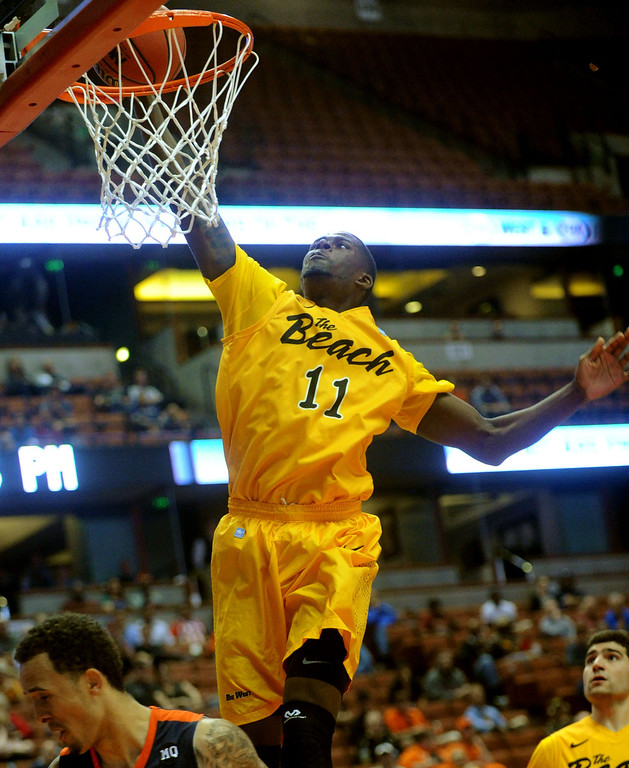. 03-14-2013--(LANG Staff Photo by Sean Hiller)- Long Beach State vs. Cal State Fullerton in Thursday\'s men\'s basketball first round game of the Big West Conference Basketball Tournament at the Honda Center in Anaheim. Long Beach\'s James Ennis (11) goes to the basket against Fullerton first half.