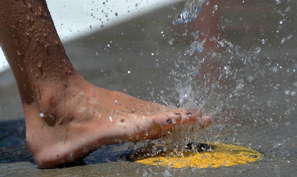 . Even toes need cooling off on a hot day at at Pirates Cove July 16, 2013.  (Photo By John Leyba/The Denver Post)