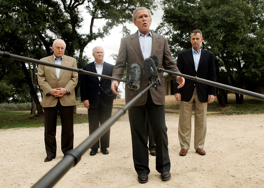 """. President Bush, center, stands with, from left,  Vice President Dick Cheney, Defense Secretary Robert Gates, and Chairman of the Joint Chiefs of Staff Gen. Peter Pace as he talks with reporters about a meeting with his national security team Thursday, Dec. 28, 2006 in Crawford, Texas.   Bush met with his national security team at his Texas ranch, and declared he had moved one step closer to devising a new Iraq strategy but would seek more advice before settling on a final plan. \""""We\'re making good progress,\"""" Bush said. (AP Photo/Evan Vucci)"""