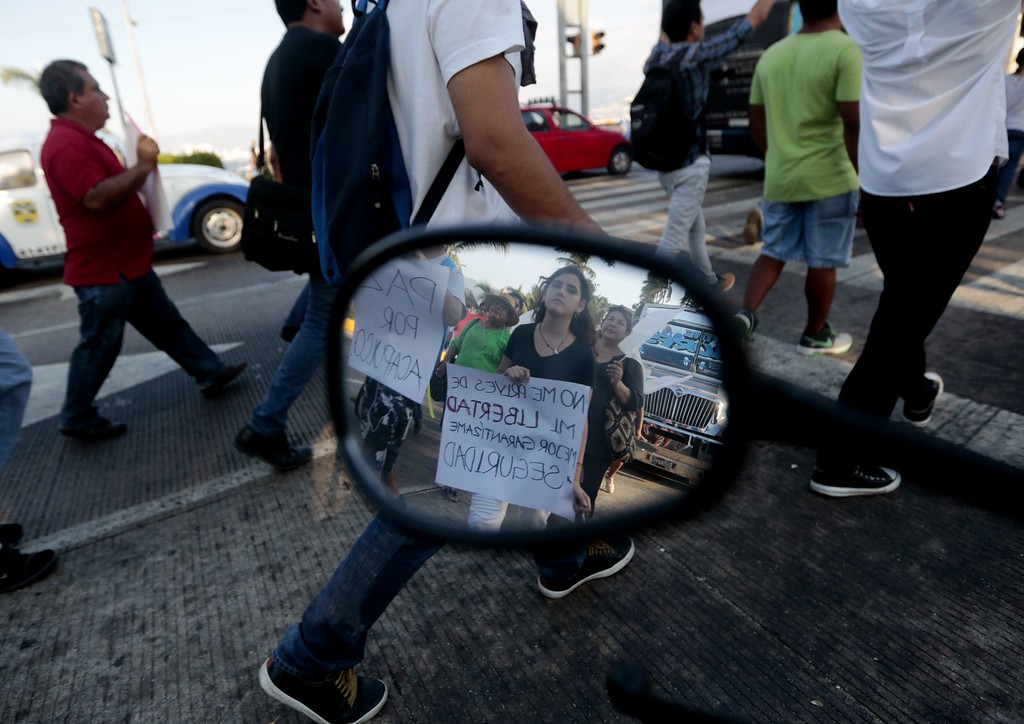 . People take part in a march for peace and against violence in Acapulco, Mexico on April 27, 2016.  Inhabitans of Acapulco marched in silence due to the wave of violence in the famous Mexican resort after a shootout last weekend between Federal Police and members of organized crime.  / AFP PHOTO / Pedro PardoPEDRO PARDO/AFP/Getty Images