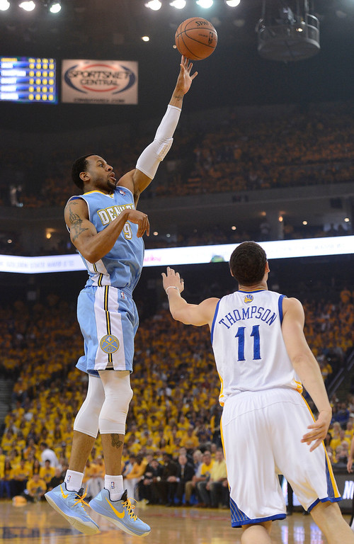 . OAKLAND, CA - APRIL 28:Andre Iguodala (9) of the Denver Nuggets hits a soft jumper over Klay Thompson (11) of the Golden State Warriors during the first quarter  in Game 3 of the first round NBA Playoffs April 28, 2013 at Oracle Arena. (Photo By John Leyba/The Denver Post)