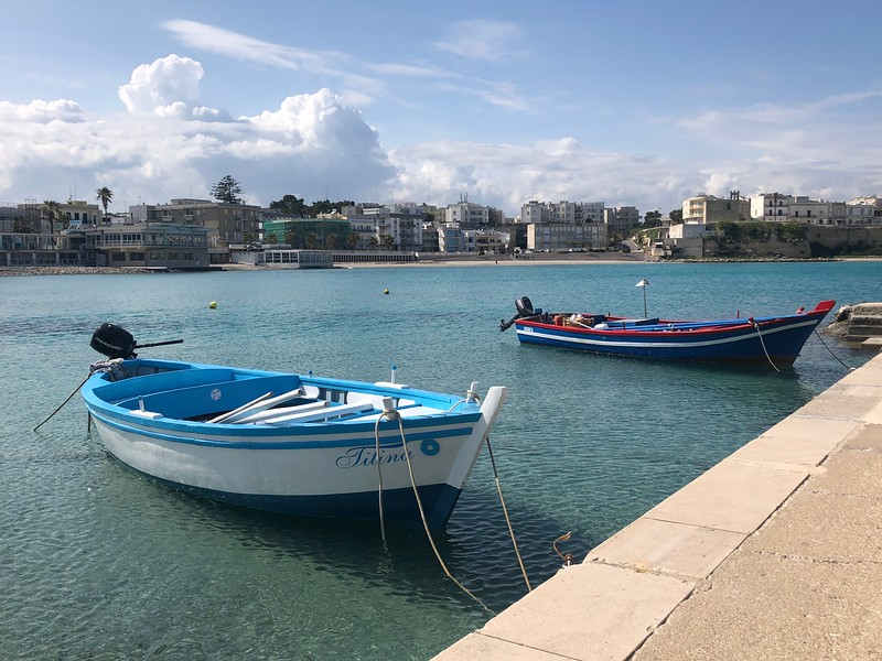 two small boats moored at a promenads