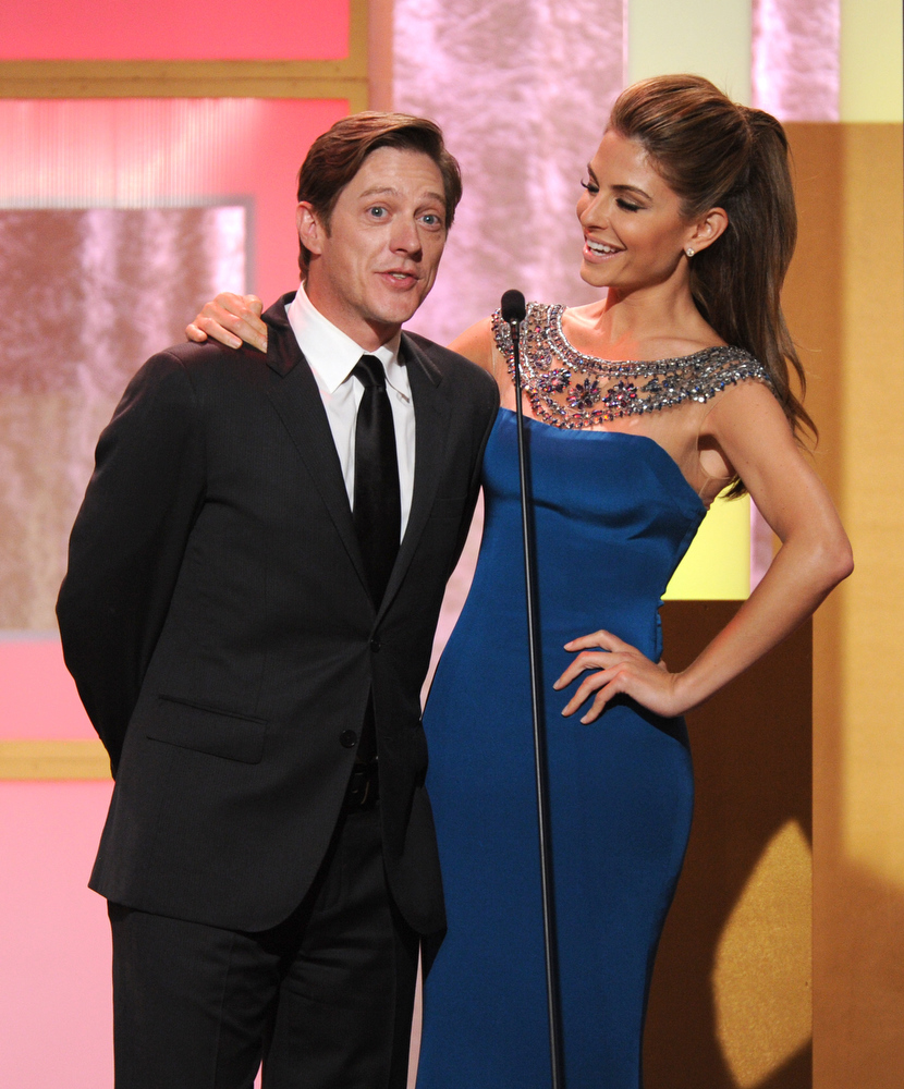 . Kevin Rahm, left, and Maria Menounos speak on stage at the Critics\' Choice Television Awards in the Beverly Hilton Hotel on Monday, June 10, 2013, in Beverly Hills, Calif. (Photo by Frank Micelotta/Invision/AP)