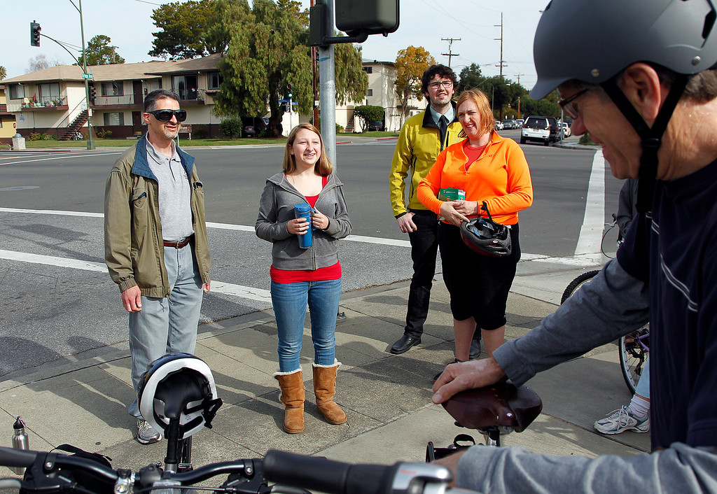 . At center, Dana Meyerson, 15, and her father Howie Meyerson, left, talk about a bicycling accident at the intersection of Ortega Ave. and California Street during the Great Streets Rengstorff Park Neighbor Bike Tour in Mountain View, Calif. on Sat., March 2, 2013. (LiPo Ching/Staff)