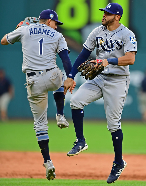 . Tampa Bay Rays\' Tommy Pham, right, Willy Adames celebrate after defeating the Cleveland Indians in a baseball game, Sunday, Sept. 2, 2018, in Cleveland. (AP Photo/David Dermer)