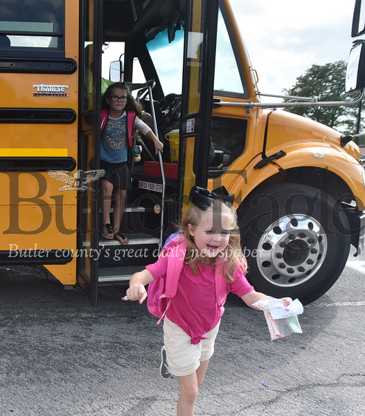 18206 Korahlin Dunnigan getting off the school bus after her first day of first grade at the South Butler Primary School