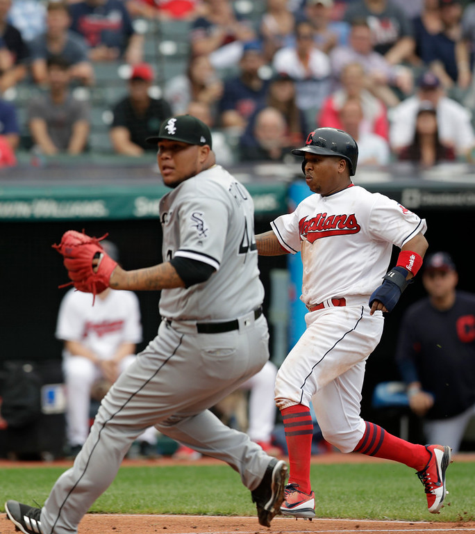 . Cleveland Indians\' Jose Ramirez, right, scores on a wild pitch by Chicago White Sox relief pitcher Bruce Rondon, left, in the sixth inning of a baseball game, Wednesday, June 20, 2018, in Cleveland. (AP Photo/Tony Dejak)