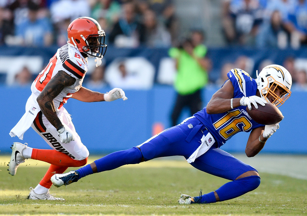 . Los Angeles Chargers wide receiver Tyrell Williams, right, catches a pass as Cleveland Browns strong safety Briean Boddy-Calhoun looks on during the second half of an NFL football game Sunday, Dec. 3, 2017, in Carson, Calif. (AP Photo/Kelvin Kuo)