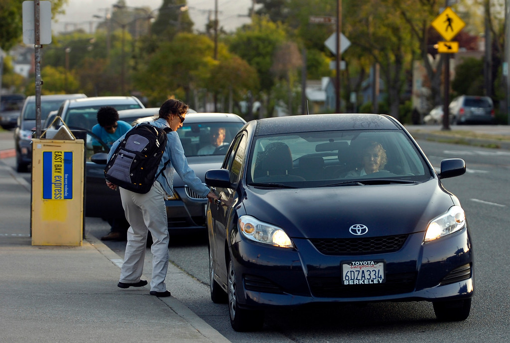 . On day 2 of the BART strike, casual carpoolers catch rides at the North Berkeley BART station in Berkeley, Calif. on Tuesday, July 2, 2013. (Kristopher Skinner/Bay Area News Group)
