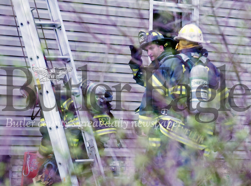 Harold Aughton/Butler Eagle: Firefighters investigate a possible lighting strike at 124 Old Glade Mills Road, Valencia Tuesday afternoon.