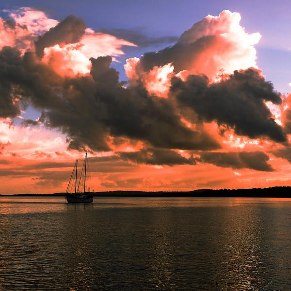 Pink colored cumulonimbus cloud, sunset seascape.
