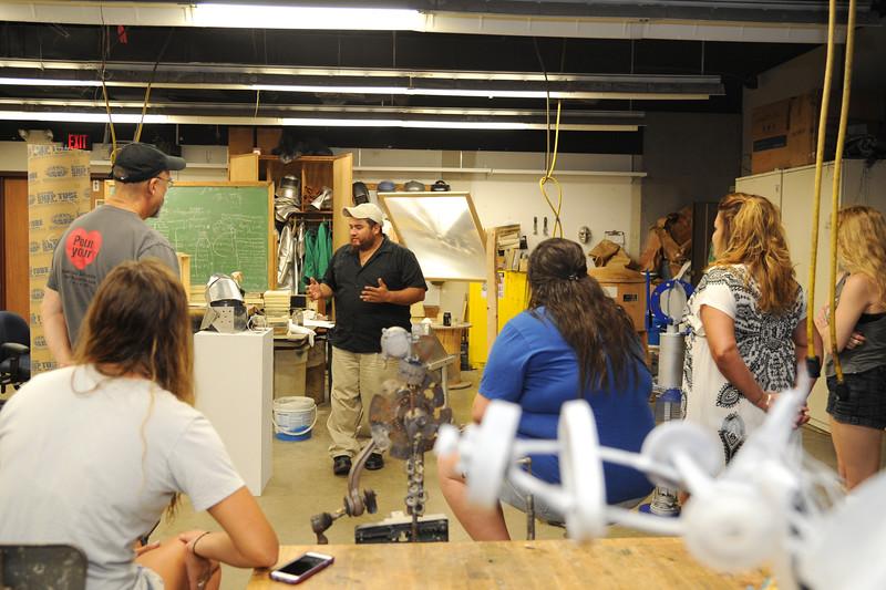 Students Jose Dalacios presents his work in Sculpture final critique.