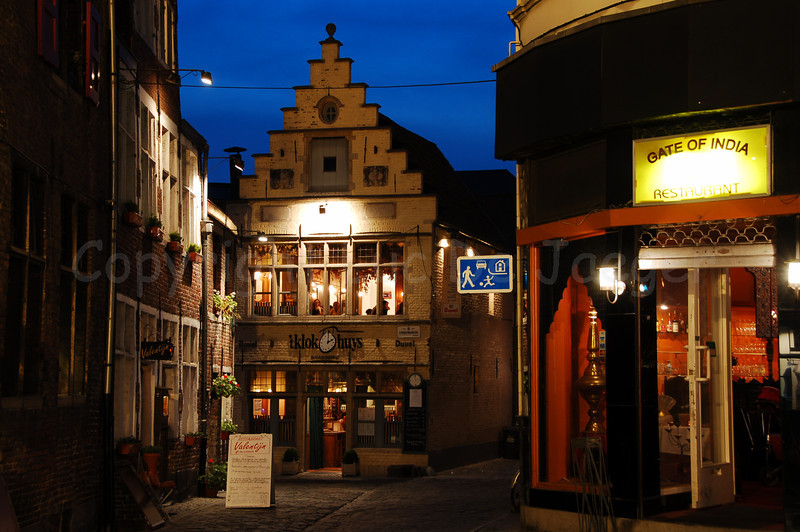 "Evening shot in the centre of Ghent (Gent), Belgium, in the neighborhood of the Vrijdagmarkt (Friday Market), the Rodekoningstraat, marking the entrance of the ""Patershol."""