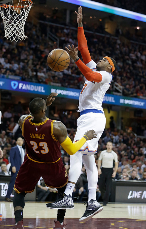 . New York Knicks\' Carmelo Anthony, right, blocks a pass to Cleveland Cavaliers\' LeBron James in the first half of an NBA basketball game, Thursday, Feb. 23, 2017, in Cleveland. (AP Photo/Tony Dejak)