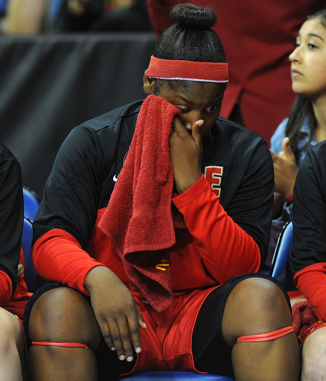. Etiwanda\'s Amy Okonkwo wipes her face after their loss at Citizens Business Bank Arena in Ontario, CA on Saturday, March 22, 2014. Long Beach Poly vs Etiwanda in the CIF girls open division regional final. 2nd half, Poly won 56-46. Photo by Scott Varley, Daily Breeze)