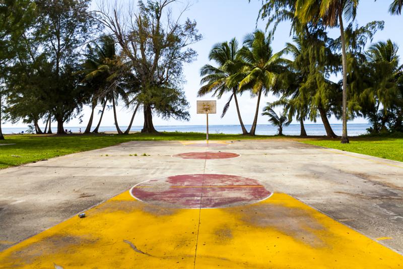 AdobeStock_56154193 Tropical beach basketball court.png
