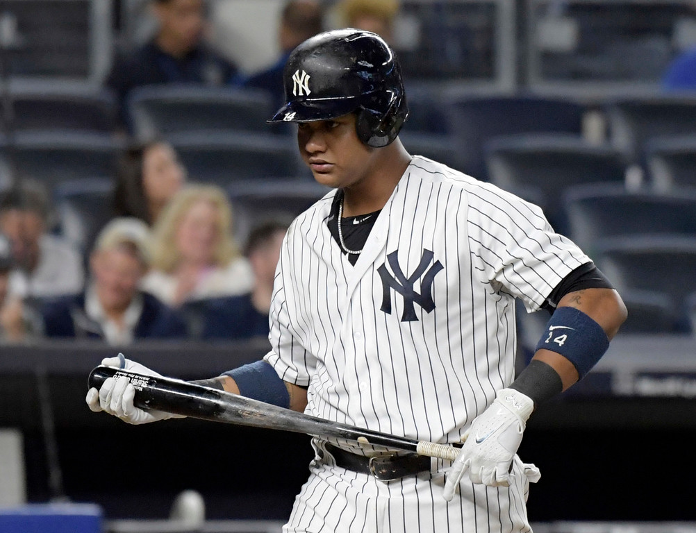 . New York Yankees\' Starlin Castro walks off the field after striking out to end the baseball game against the Cleveland Indians Monday, Aug. 28, 2017, at Yankee Stadium in New York. The Indians won 6-2. (AP Photo/Bill Kostroun)