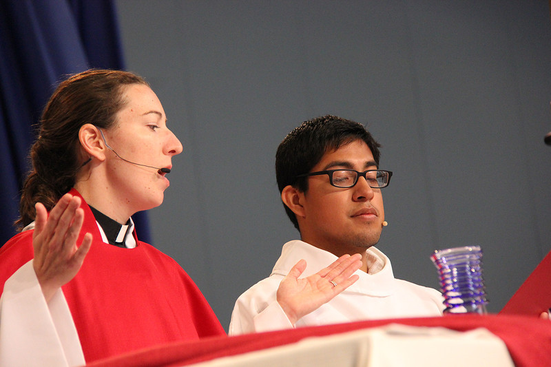 Holy Communion is shared during worship by the Rev. Erin Evans and the Rev. David Rojas Martinez.