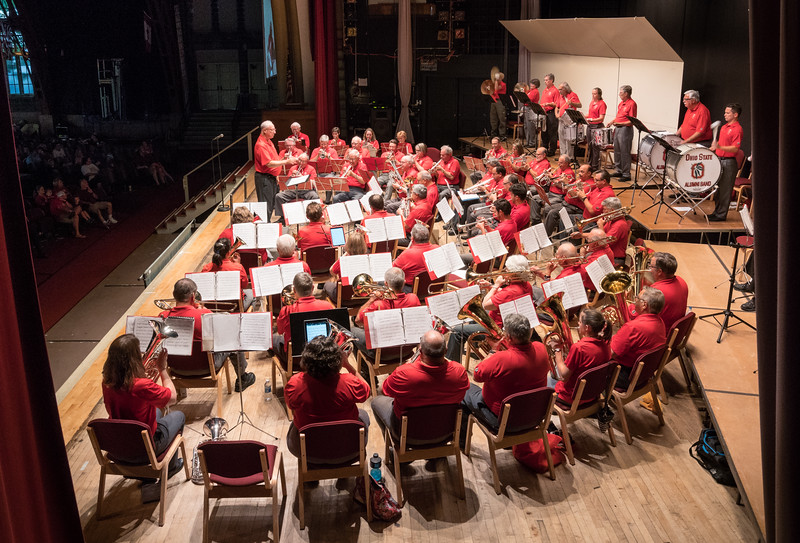 """Dr. Paul Droste conducts """"The Challenge"""".  Thomas A. Myers arranged the march for TBDBITL Alumni and dedicated it to Dr. Droste."""