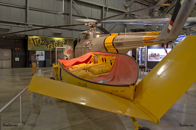 """National Museum of the United States Air Force, Dayton, Ohio,   04/13/2019  A-3 Lifeboat #603.    Dropped by SB-29s in the Korean Offensive  to rescue downed allied aircrews.    In back is Sikorsky UH-19B  Chickasaw C/N 55-734  52-7587  Displayed here as a H-19A c/n 55-172 51-3893  named """"Hopalong""""  This work is licensed under a Creative Commons Attribution- NonCommercial 4.0 International License."""