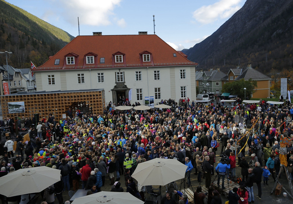 """. People gather during the official inauguration of giant mirrors (\""""Solspeilet\"""") on the hillside above Rjukan, aimed to reflect sunlight down on the town square, on October 30, 2013, 100 years after the idea was first released.  AFP PHOTO / KRISTER SOERBOE/AFP/Getty Images"""