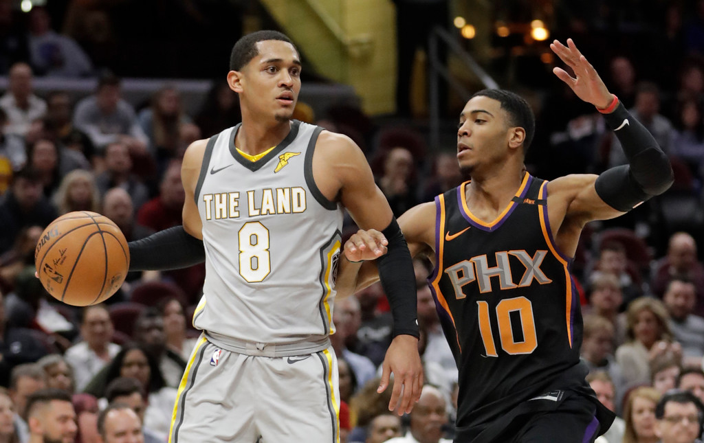 . Cleveland Cavaliers\' Jordan Clarkson (8) drive past Phoenix Suns\' Shaquille Harrison (10) in the second half of an NBA basketball game, Friday, March 23, 2018, in Cleveland. (AP Photo/Tony Dejak)