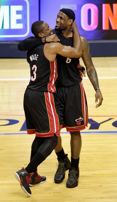 . Miami Heat forward LeBron James, right, hugs Dwyane Wade in the closing seconds of the second half of Game 4 of their NBA basketball Eastern Conference semifinal playoff series against the Indiana Pacers, Sunday, May 20, 2012, in Indianapolis. The Heat won 101-93. (AP Photo/AJ Mast)