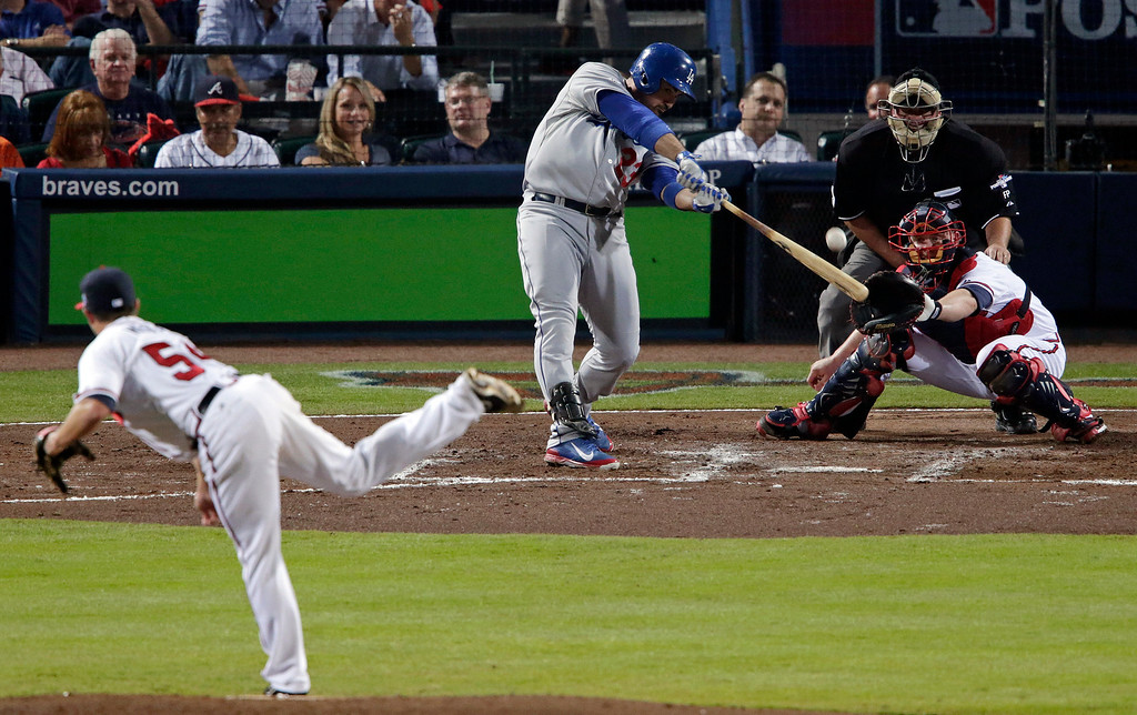 . Los Angeles Dodgers Adrian Gonzalez (23) hits a two-run home run against the Atlanta Braves in the third inning of Game 1 of the National League Divisional Series, Thursday, Oct. 3, 2013, in Atlanta.  (AP Photo/Dave Martin)