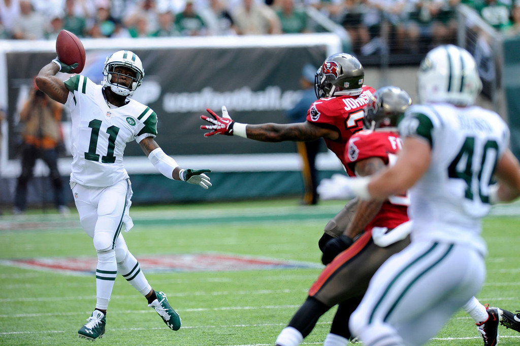 . New York Jets wide receiver Jeremy Kerley throws a pass against the Tampa Bay Buccaneers in the first half of an NFL football game, Sunday, Sept. 8, 2013, in East Rutherford, N.J. (AP Photo/Bill Kostroun)