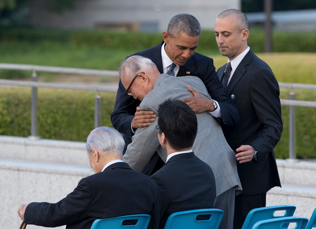 . U.S. President Barack Obama hugs Shigeaki Mori, an atomic bomb survivor; creator of the memorial for American WWII POWs killed at Hiroshima, during a ceremony at Hiroshima Peace Memorial Park in Hiroshima, western Japan, Friday, May 27, 2016. Obama on Friday became the first sitting U.S. president to visit the site of the world\'s first atomic bomb attack, bringing global attention both to survivors and to his unfulfilled vision of a world without nuclear weapons. (AP Photo Carolyn Kaster)
