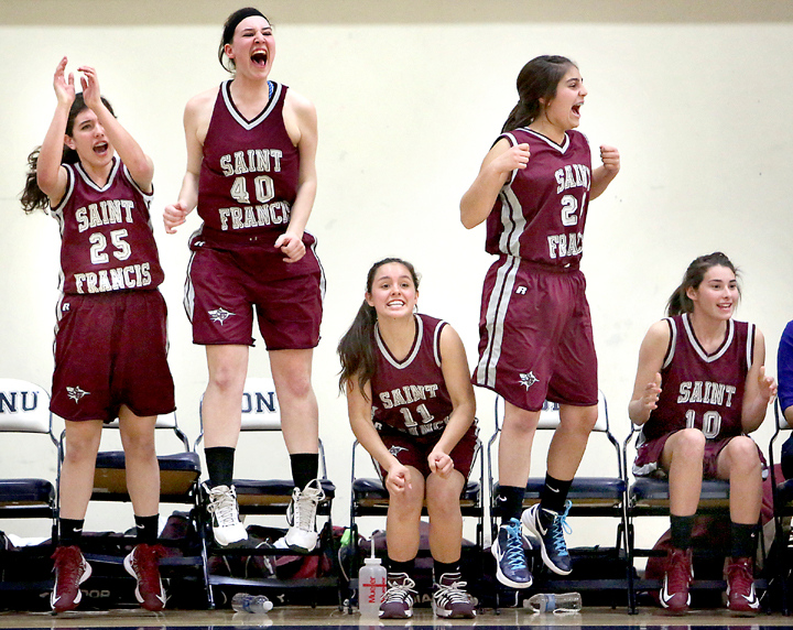 . The St. Francis girls varsity team leaps from the bench in excitement after defeating Pacific Collegiate High School in the CCS Division V Championship at Notre Dame de Namur University in Belmont on Friday night. (Kevin Johnson/Sentinel)