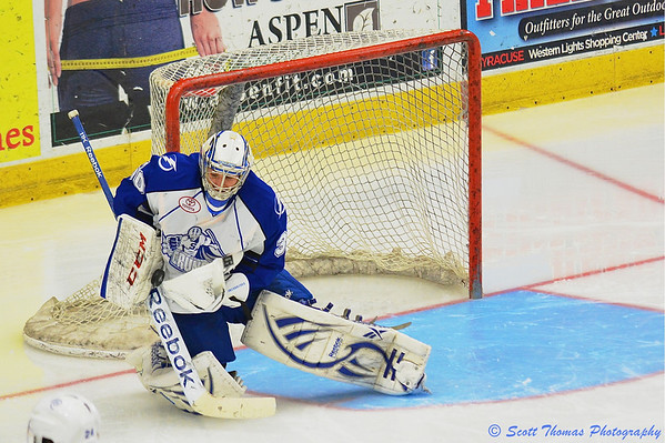 Syracuse Crunch goalie Cedrick Desjardins (30) makes a save during overtime against the Portland Pirates in American Hockey League (AHL) Calder Cup playoff action at the Onondaga County War Memorial on Saturday, April 27, 2013.