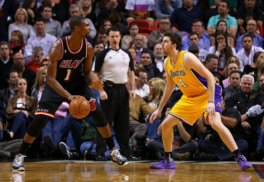 . Chris Bosh #1 of the Miami Heat posts up Ryan Kelly #4 of the Los Angeles Lakers during a game  at American Airlines Arena on January 23, 2014 in Miami, Florida.  (Photo by Mike Ehrmann/Getty Images)