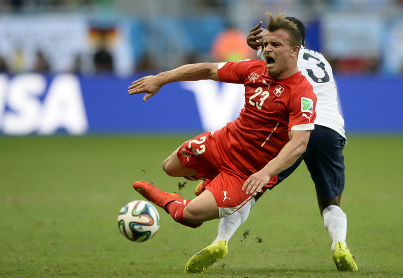 . Switzerland\'s midfielder Xherdan Shaqiri (L) vies with France\'s defender Patrice Evra (R) during a Group E football match between Switzerland and France at the Fonte Nova Arena in Salvador during the 2014 FIFA World Cup on June 20, 2014.  (FRANCK FIFE/AFP/Getty Images)