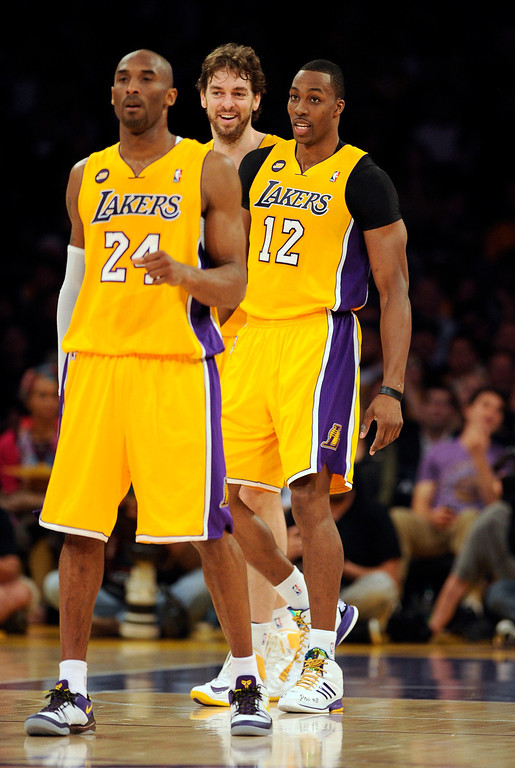 . Lakers\' Kobe Bryant #24, Dwight Howard #12 and Pau Gasol #16 during their game against the Warriors at the Staples Center in Los Angeles Friday, April 12, 2013. (Hans Gutknecht/Staff Photographer)