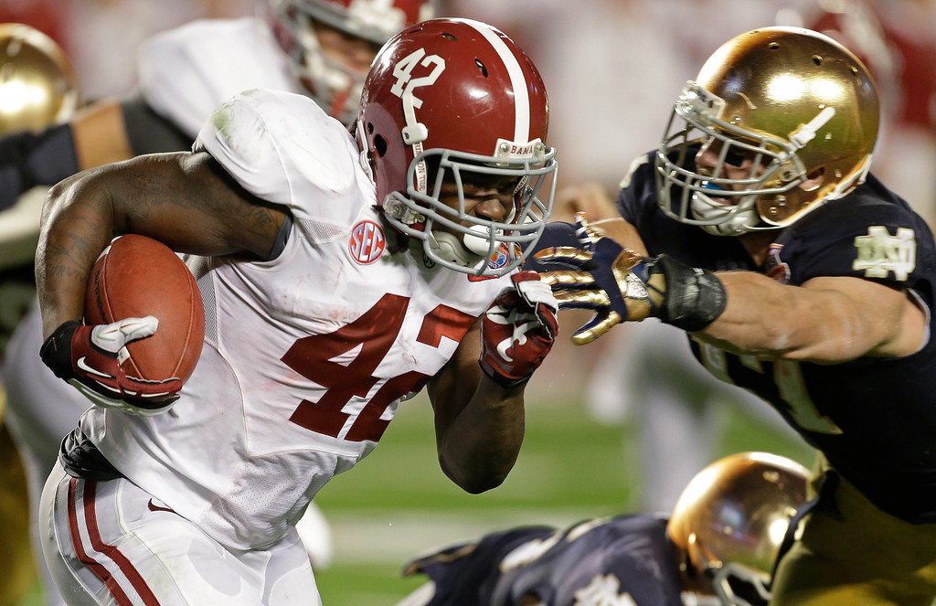 . Alabama\'s Eddie Lacy runs during the first half of the BCS National Championship college football game against Notre Dame Monday, Jan. 7, 2013, in Miami. (AP Photo/Chris O\'Meara)