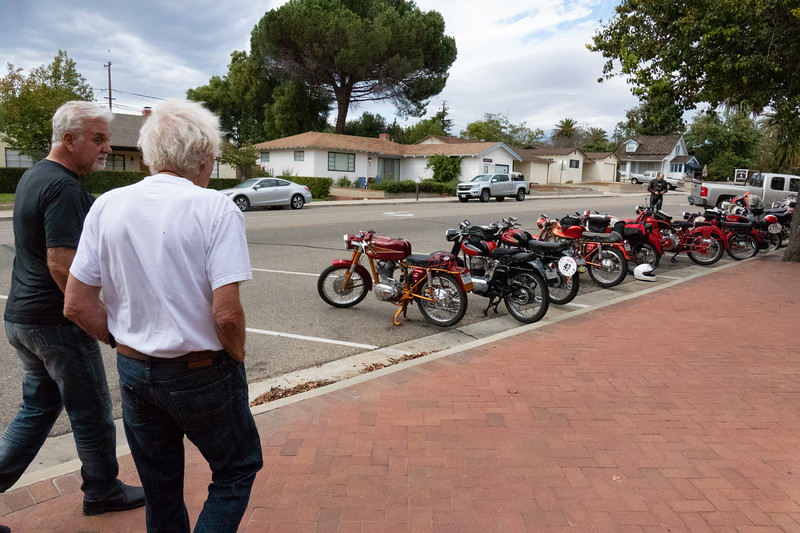 Showing the Museum owner our little bikes