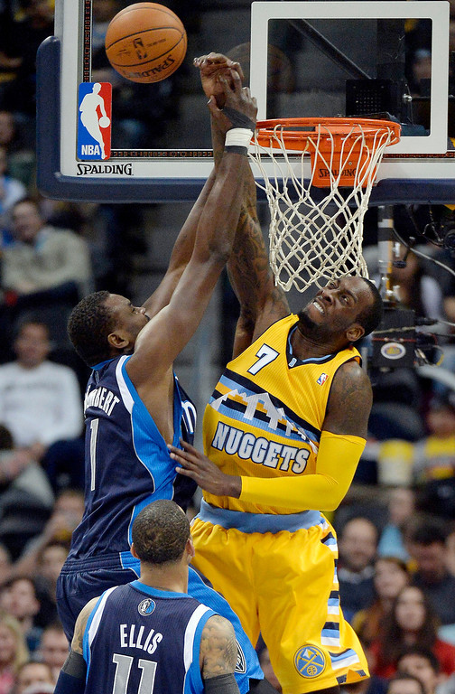 . Denver Nuggets center J.J. Hickson (7) blocks a shot by Dallas Mavericks center Samuel Dalembert (1) during the second quarter March 5, 2014 at Pepsi Center. (Photo by John Leyba/The Denver Post)