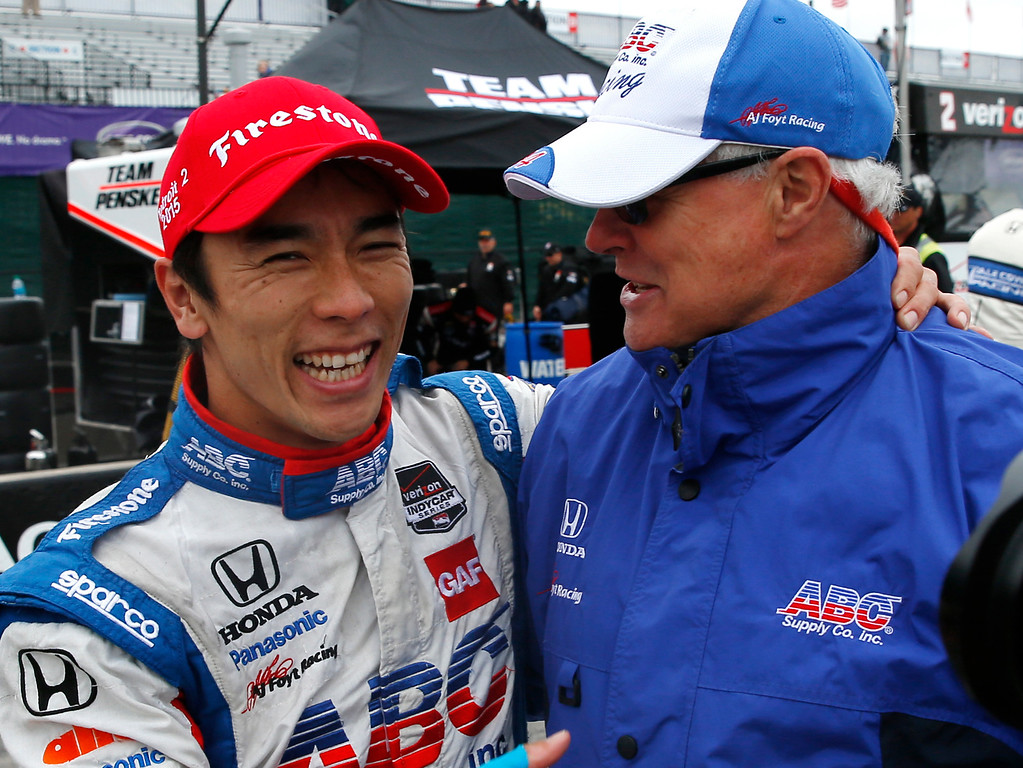 . Takuma Sato, left, of Japan, celebrates his second-place finish with team chief engineer Don Halliday after the second race of the IndyCar Detroit Grand Prix auto racing doubleheader, Sunday, May 31, 2015, in Detroit. (AP Photo/Paul Sancya)