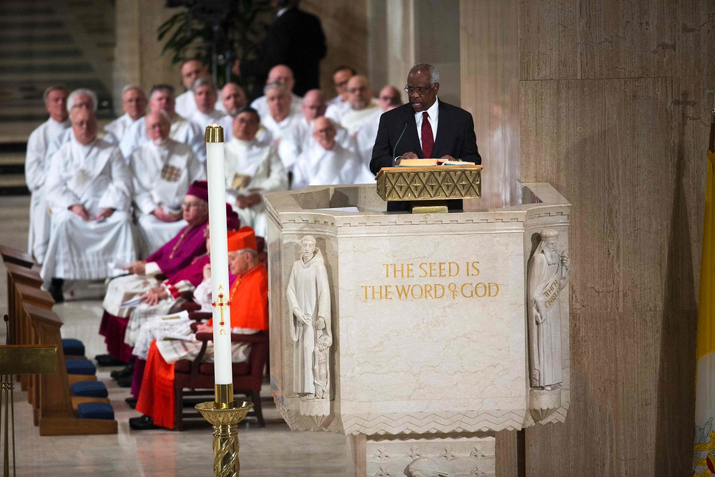 . Justice Clarence Thomas makes a reading during the funeral Mass for US Supreme Court Justice Antonin Scalia at the Basilica of the National Shrine of the Immaculate Conception in Washington, DC,  on February 20, 2016. / AFP / POOL / Doug  MILLS/AFP/Getty Images