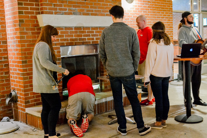 Faculty and students trying to get the fireplace started