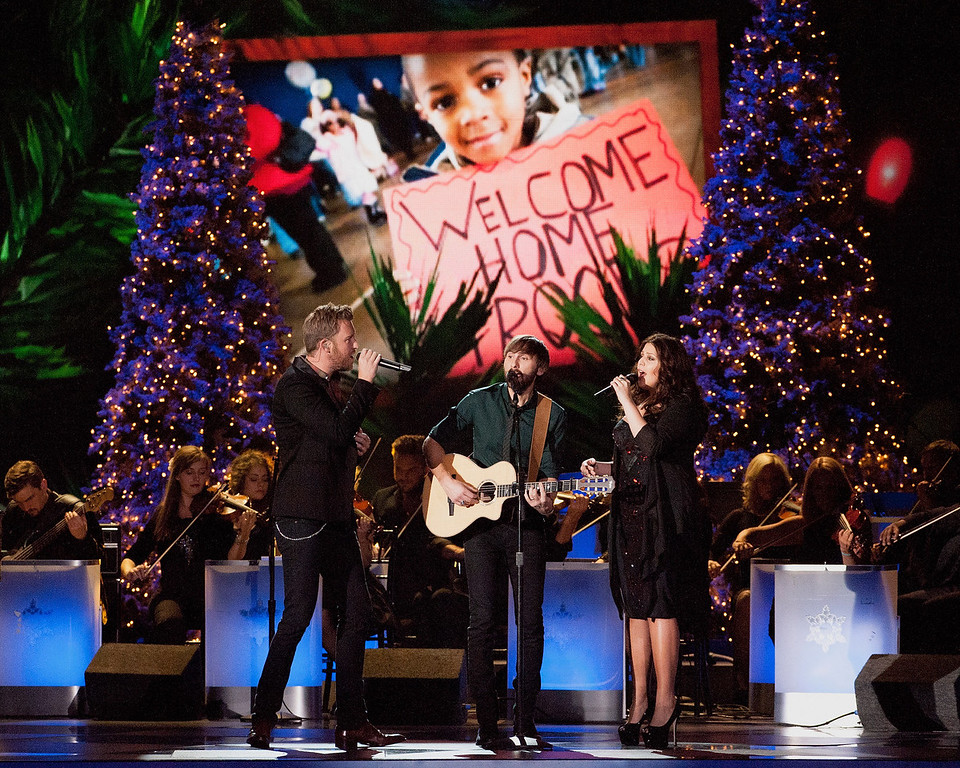 . (L-R)Charles Kelley,  Dave Haywood and Hillary Scott of Lady Antebellum perform during the CMA 2013 Country Christmas on November 8, 2013 in Nashville, Tennessee.  (Photo by Erika Goldring/Getty Images)