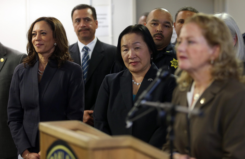 . State Attorney General Kamala Harris, left, and Oakland Mayor Jean Quan, center, listen as Alameda County District Attorney Nancy O\'Malley, right, speaks during a press conference at the Oakland Emergency Operations Center in Oakland, Calif., on Friday, March 8, 2013.  (Jane Tyska/Staff)