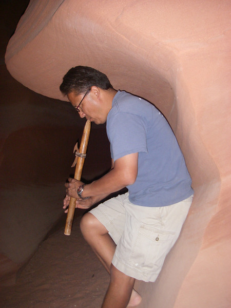 Antelope Canyon is visited exclusively through guided tours. Our Guide in Kokopeli pose. According to Hopi Indian legend, Kokopeli (the flute player and traveling prankster) was the symbol of happiness, joy, and fertility