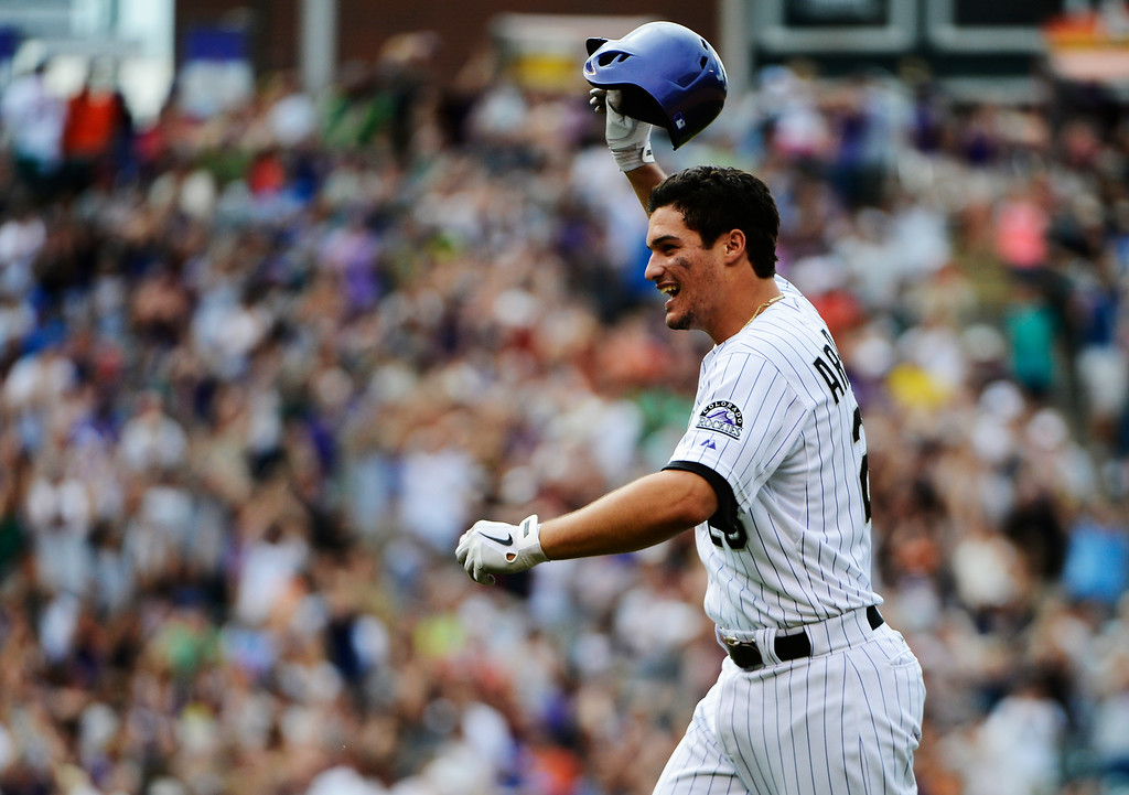 . DENVER, CO - JUNE 27: Colorado Rockies third baseman, Nolan Arenado celebrates after hitting a walk-off game winning single to defeat the San Francisco Giants 2-1 at Coors Field Saturday afternoon, June 29, 2013. (Photo By Andy Cross/The Denver Post)
