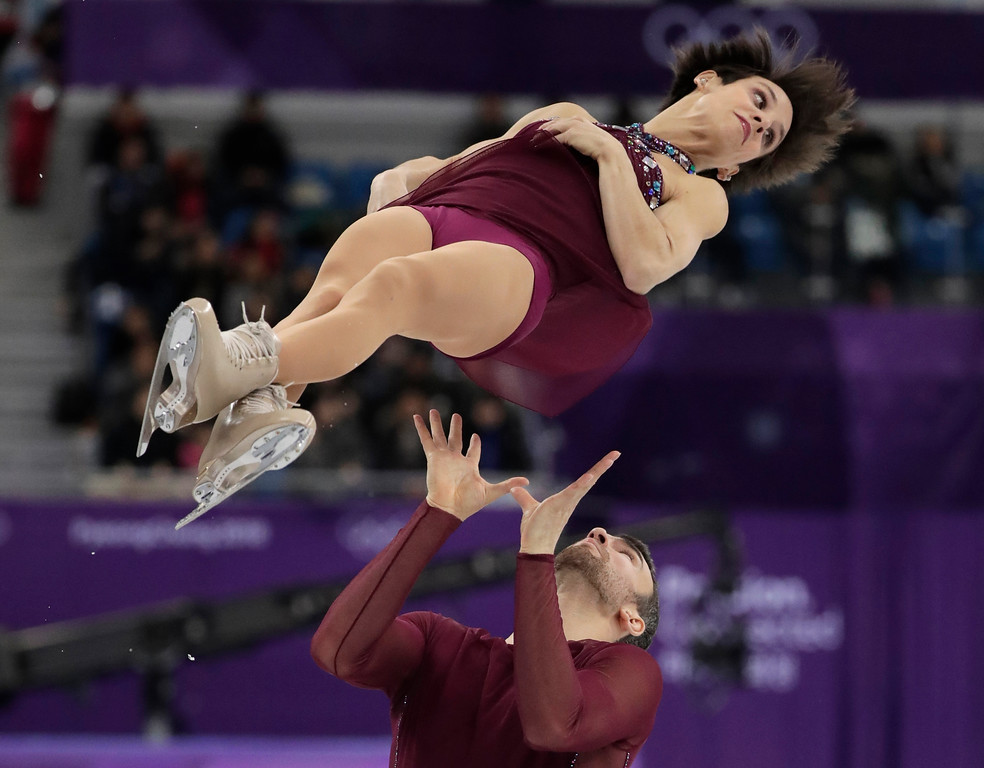 . Meagan Duhamel and Eric Radford of Canada perform in the pairs free skate figure skating final in the Gangneung Ice Arena at the 2018 Winter Olympics in Gangneung, South Korea, Thursday, Feb. 15, 2018. (AP Photo/Julie Jacobson)