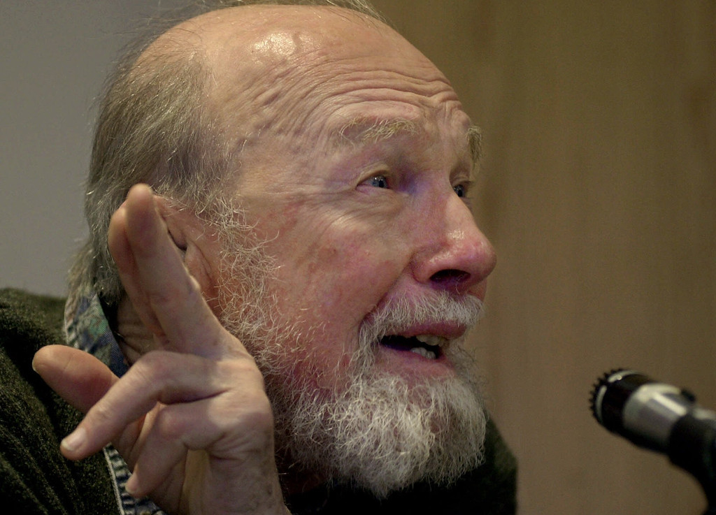 ". Legendary folk singer and social activist Pete Seeger, 81, speaks to students and faculty Monday, Jan. 29, 2001, during a forum at  Brandeis University in Waltham, Mass., called ""Cultural Work, Coexistence and Community Development: a Conversation with Pete Seeger.\"" The central theme of the forum was a discussion on how to build community through songs of social justice. (AP Photo/Steven Senne)"