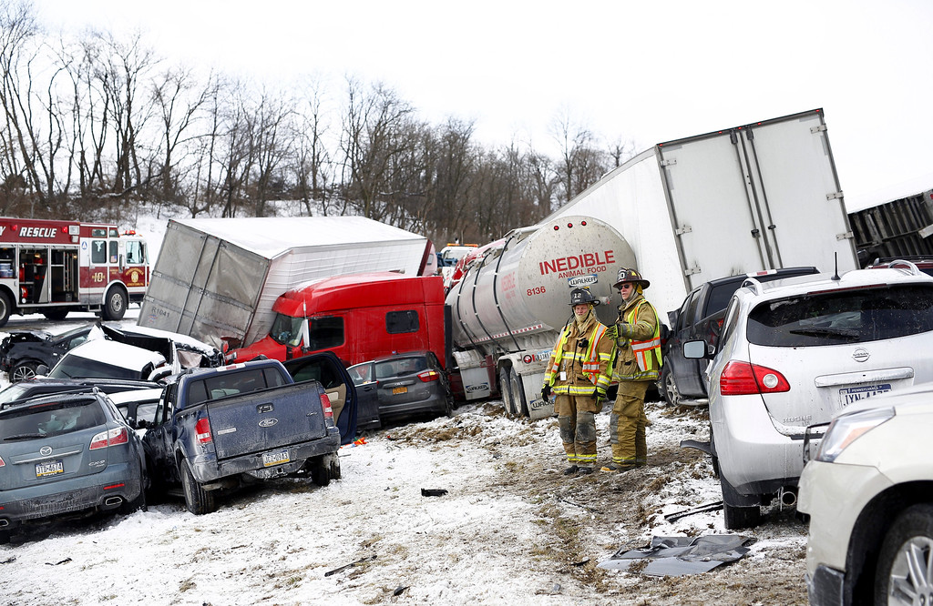 . Emergency personnel work at the scene of a crash near Fredricksburg, Pa., Saturday, Feb. 13, 2016. State police say a pileup has closed Interstate 78 in central Pennsylvania. (Daniel Zampogna/PennLive.com via AP)