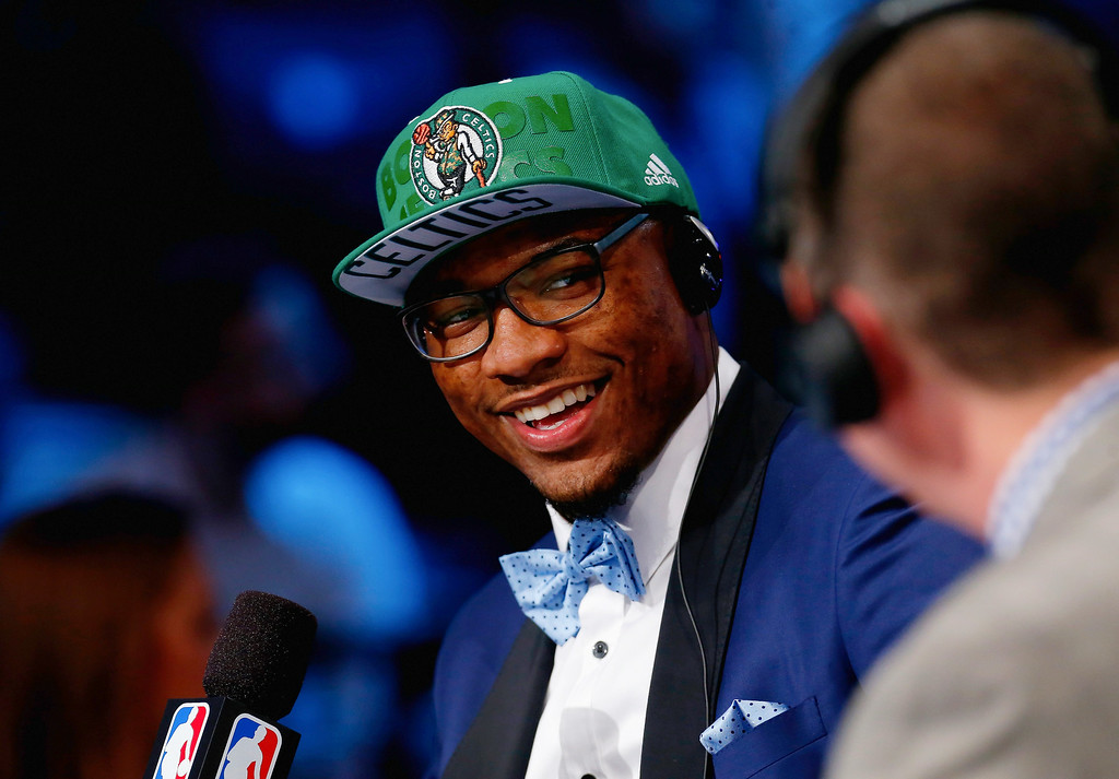 . Marcus Smart (R) of Oklahoma State is interviewed after being selected with the #6 overall pick by the Boston Celtics during the 2014 NBA Draft at Barclays Center on June 26, 2014 in the Brooklyn borough of New York City.   (Photo by Mike Stobe/Getty Images)