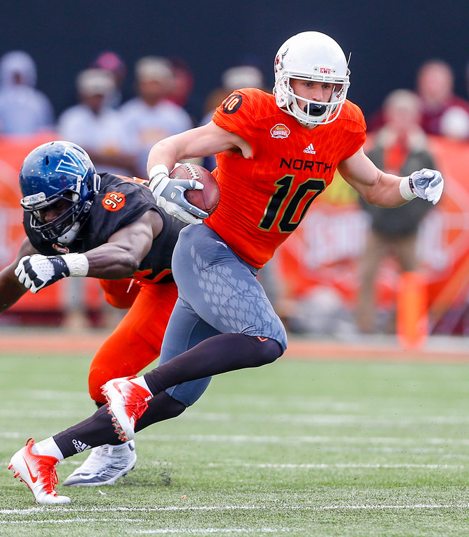 . North squad wide receiver Cooper Kupp of Eastern Washington (10) carries the ball as he gets around South squad defensive end Tanoh Kpassagnon of Villanova (92) during the first half of the Senior Bowl NCAA college football game, Saturday, Jan. 28, 2017, at Ladd-Peebles Stadium in Mobile, Ala. (AP Photo/Butch Dill)